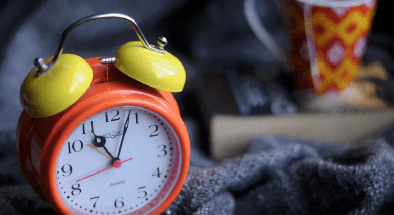 Orange and yellow alarm clock
