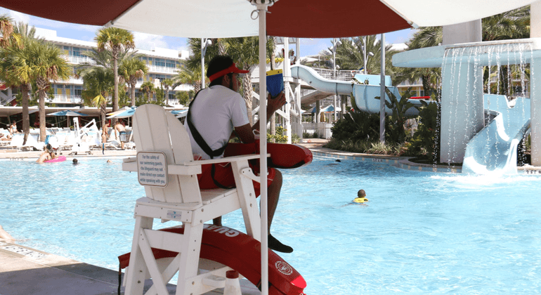 Male lifeguard on duty at a hotel pool