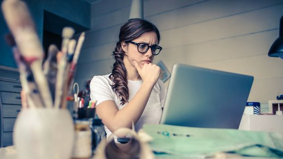 Worried young woman using a laptop